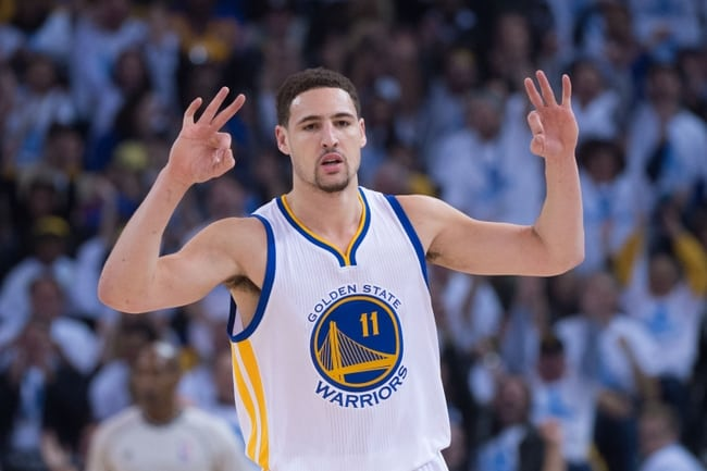 January 5, 2015; Oakland, CA, USA; Golden State Warriors guard Klay Thompson (11) celebrates after making a three-point basket during the first quarter against the Oklahoma City Thunder at Oracle Arena. The Warriors defeated the Thunder 117-91. Mandatory Credit: Kyle Terada-USA TODAY Sports