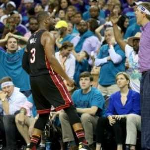CHARLOTTE, NC - APRIL 29: Dwyane Wade #3 of the Miami Heat reacts after making a shot late in the fourth quarter against the Charlotte Hornets during game six of the Eastern Conference Quarterfinals of the 2016 NBA Playoffs at Time Warner Cable Arena on April 29, 2016 in Charlotte, North Carolina. NOTE TO USER: User expressly acknowledges and agrees that, by downloading and or using this photograph, User is consenting to the terms and conditions of the Getty Images License Agreement. (Photo by Streeter Lecka/Getty Images)