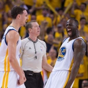 May 13, 2015; Oakland, CA, USA; Golden State Warriors guard Klay Thompson (11, left) is congratulated by forward Draymond Green (23, right) after making a three-point basket while being fouled during the fourth quarter in game five of the second round of the NBA Playoffs against the Memphis Grizzlies at Oracle Arena. The Warriors defeated the Grizzlies 98-78. Mandatory Credit: Kyle Terada-USA TODAY Sports