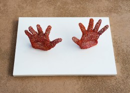 sculpture of hands made from telephone wire