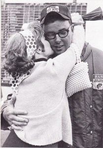 1970 Bass Master Trail. Bill Dance receives a hug from his wife upon winning his 5th Bassmaster event. Photo Summer 1970 issue of Bassmaster Magazine.