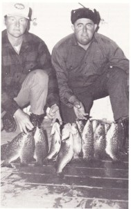 Billy Westmorland and Jerry McKinnis display a hefty string of smallies caught on Slide heads. Photo courtesy of Charlie Brewer Jr., Charlie Brewer on Slider Fishin' 1978.