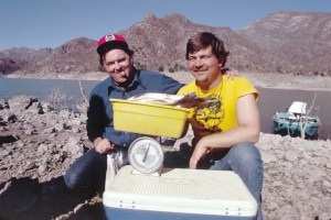 """Bob Cobb (left) clowns for the camera during the """"weigh-in"""" of our first trip to Novillo. Photo courtesy of Dave Precht."""
