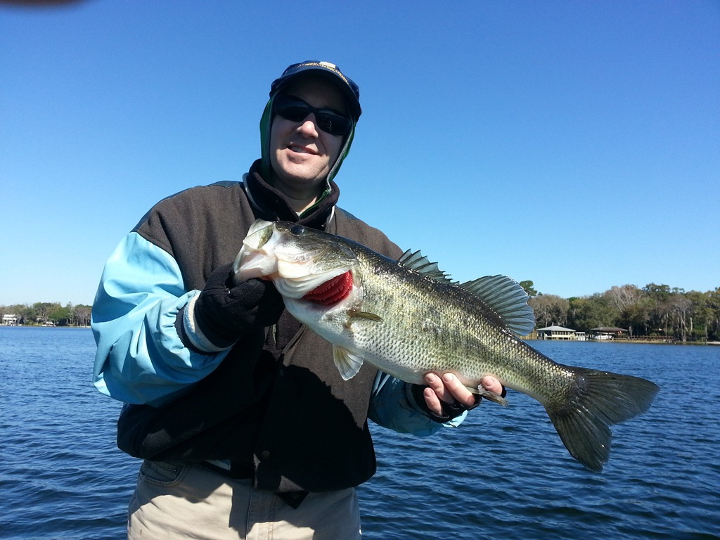 Father and sons fishing on lake toho central florida for Fishing jobs in florida