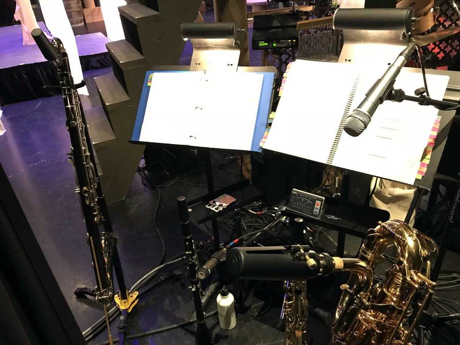 The Hunchback of Notre Dame, my pit orchestra set-up, bass clarinet, clarinet, soprano sax, bari sax, microphones, music stands, sheet music