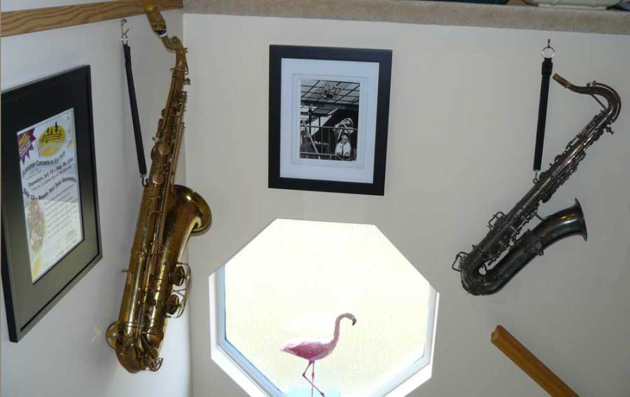 saxophones, photos, octagonal window, wall decorations