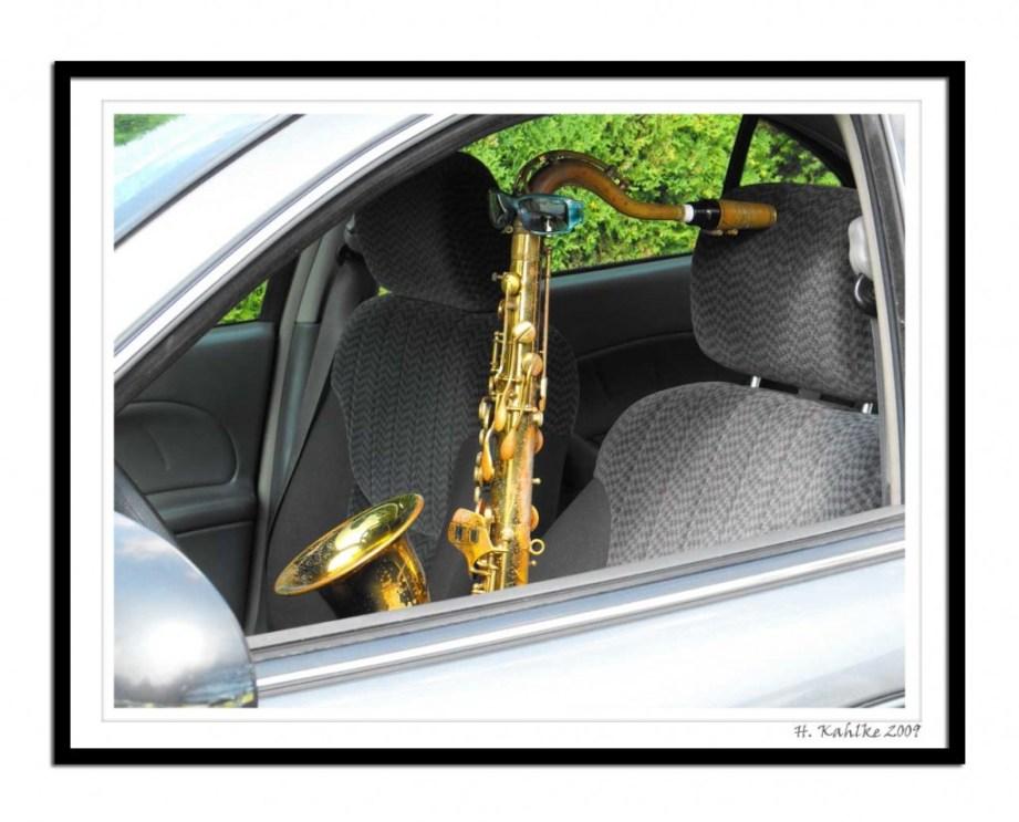 tenor saxophone, sunglasses, car interior,
