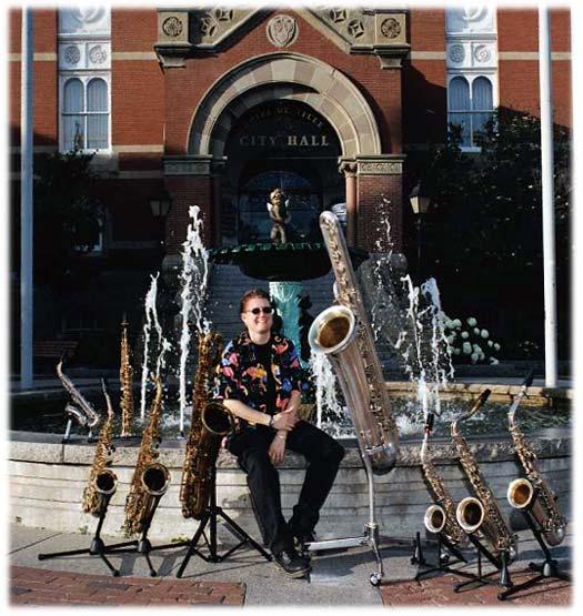 city hall, Fredericton, NB, fountain, saxophones, female saxophone player, bass saxophone, soprano sax, alto sax, tenor sax, baritone sax, C melody sax