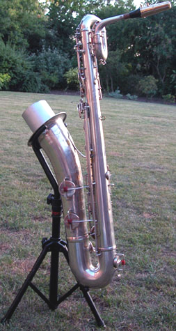 baritone sax, Adolphe Sax baritone, Selmer baritone sax, silver sax, low A extension, grass, trees, saxophone stand