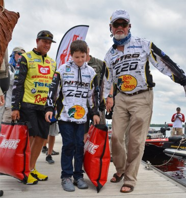 We were there for history when Rick Clunn, son River and friend Skeet Reese carried Clunn's winning bag to the stage at the St. Johns River. Photo by Joel Shangle.