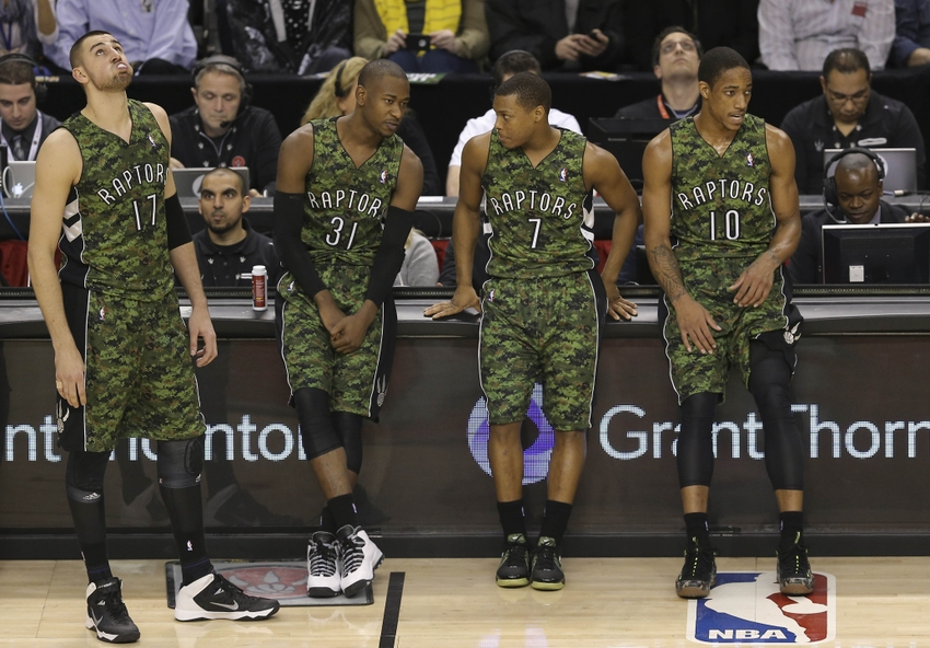 d255ef11770 ... Raptors center Jonas Valanciunas (17) and guard Terrence Ross (31) and  point guard Kyle Lowry (7) and guard DeMar DeRozan (10) wear their camo  jerseys ...