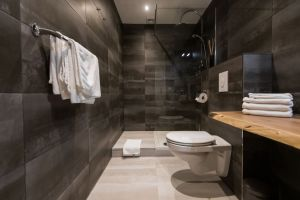 modern bathroom remodel with black tile