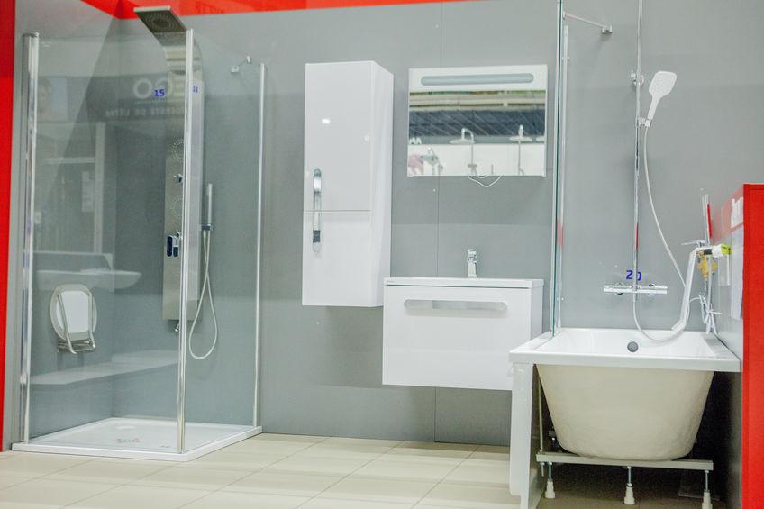 Spacious bathroom in gray tones with freestanding tub, walk-in shower, double sink vanity.