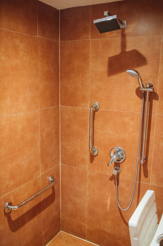 shower with seat and grab bars for disabled and elderly people in the bathroom.