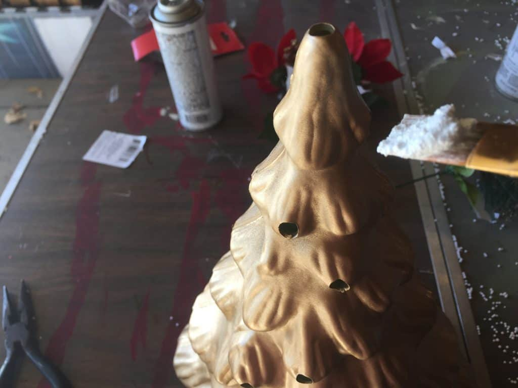 DIY retro ceramic style Christmas tree with snow flocking being added