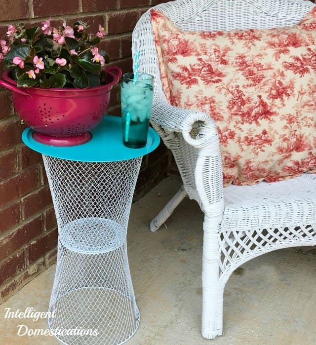 Make a side table for your backyard out of dollar store wire baskets.