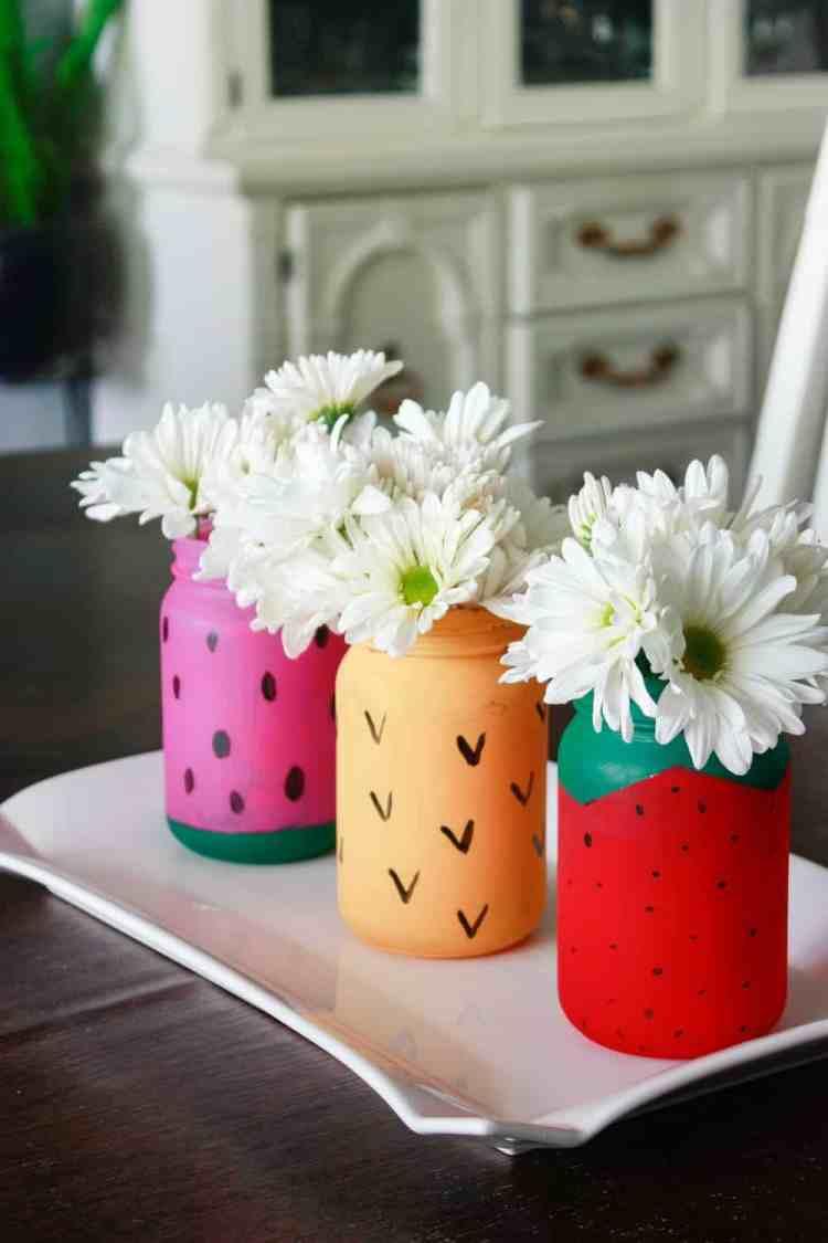 Three mason jars painted to look like fruit.