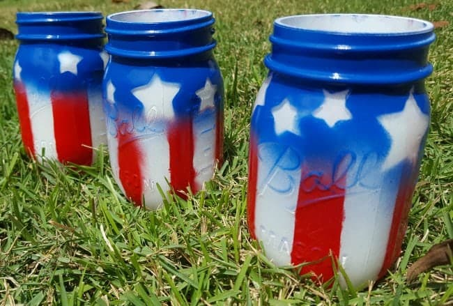 A mason jar spray painted to look like an American flag.