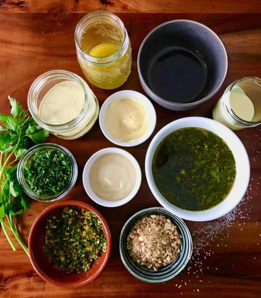 An assortment of sauces and spices for enhancing flavor at your burger bar.