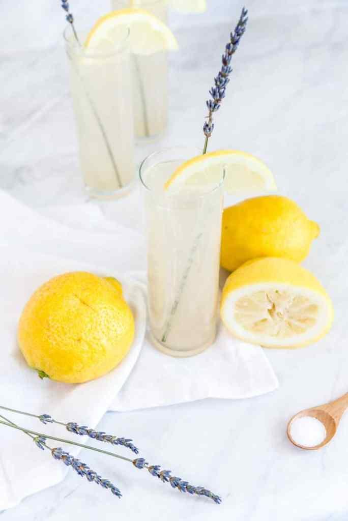Lavender pear juice lemonade in a glass.