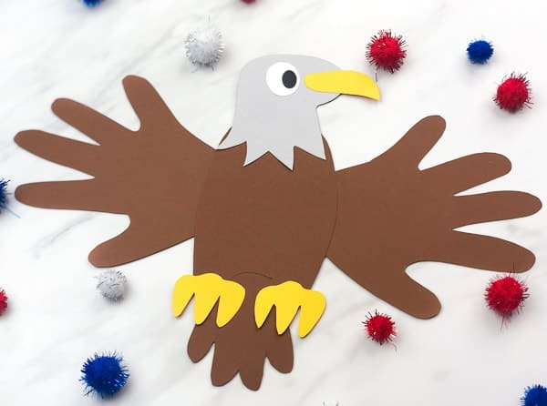 A 4th of July paper bald eagle with the wings traced from kids hands.