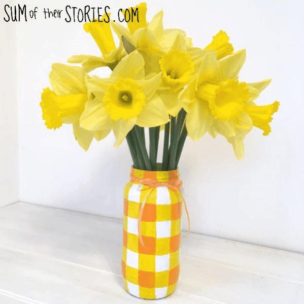 A yellow checkered mason jar vase.