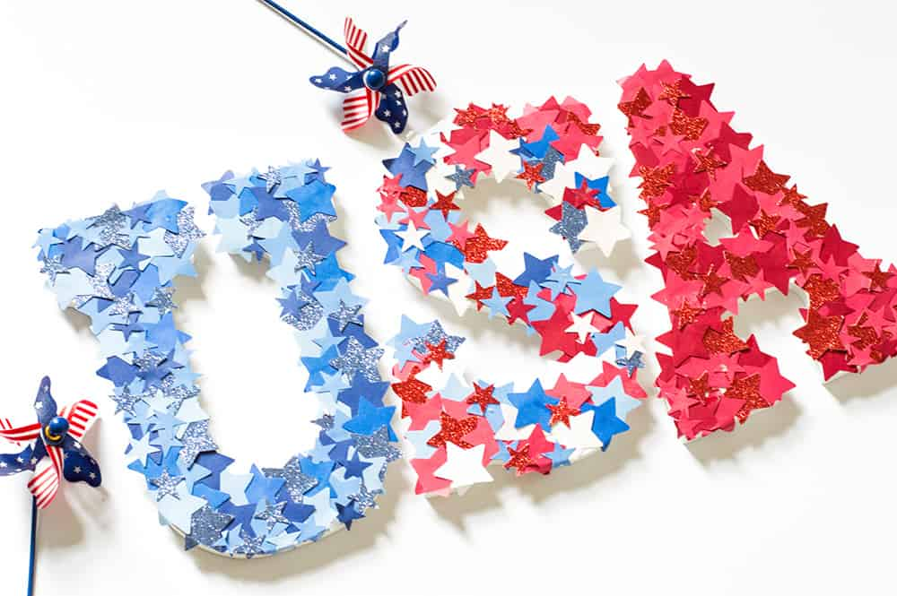 The letters USA covered in red white and blue stars.