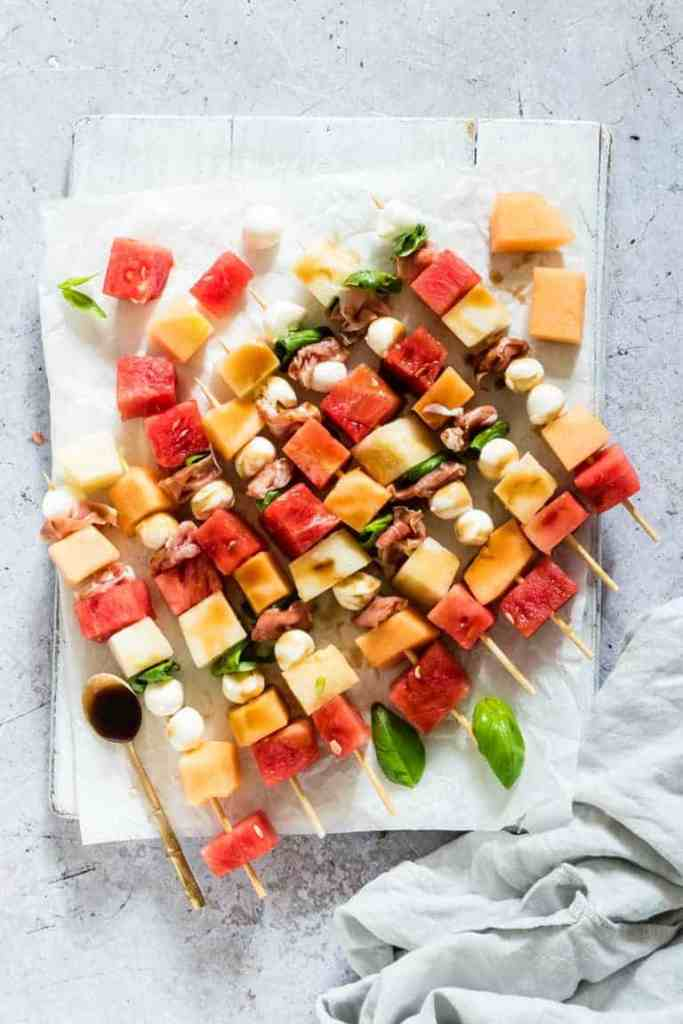 Skewers filled with watermelon, cheese and cantaloupe.