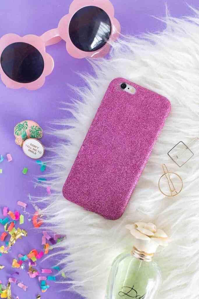 a DIY pink glitter phone case