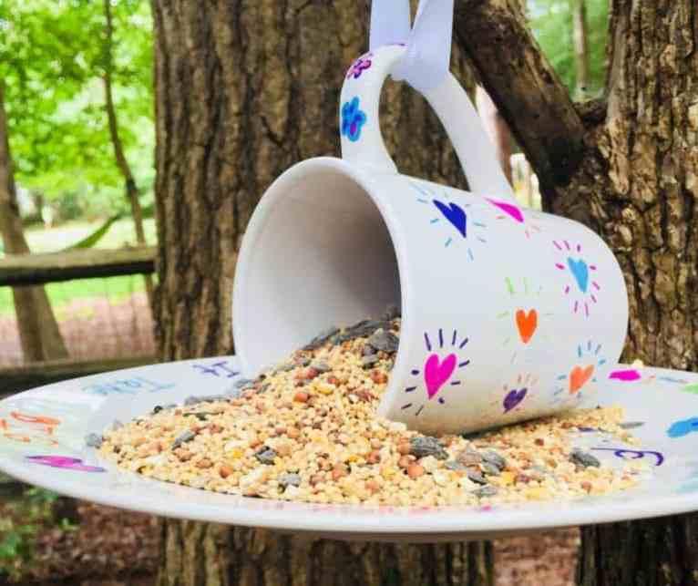 a decorated mug bird feeder