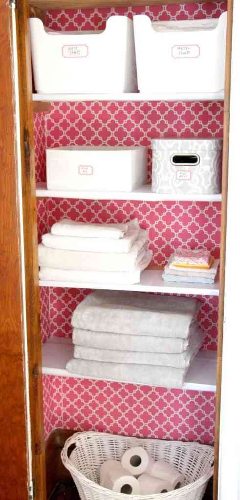 DIY Linen closet makeover with wallpaper and storage bins