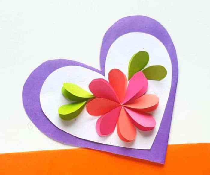 A pink flower in a heart used as a paper card for teens to make