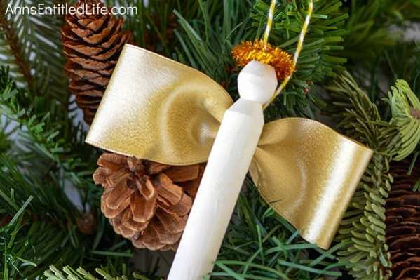 An angel ornament DIY with ribbon wings and pipe cleaner halo