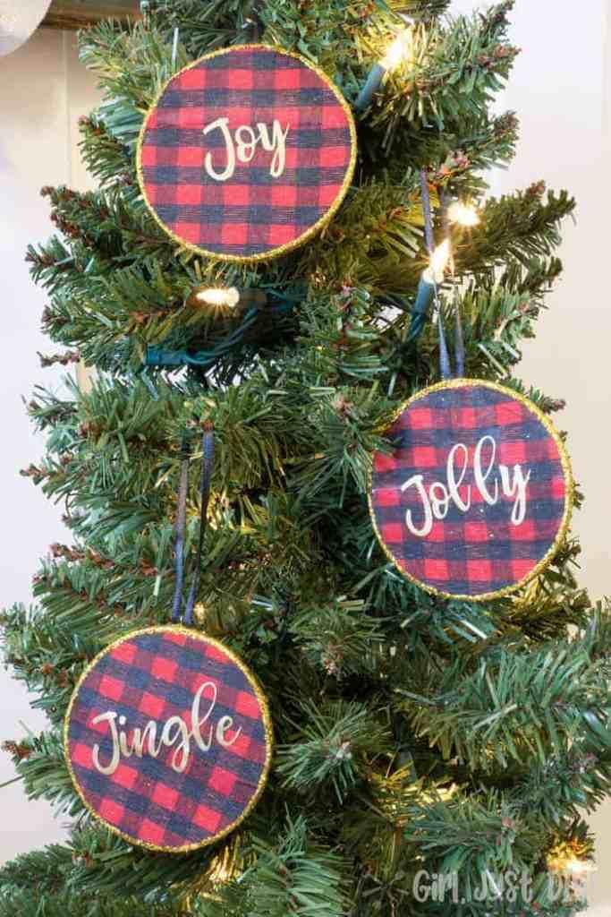 "three DIY reversible buffalo plaid ornament with cursive words ""jolly, jingle and joy"""