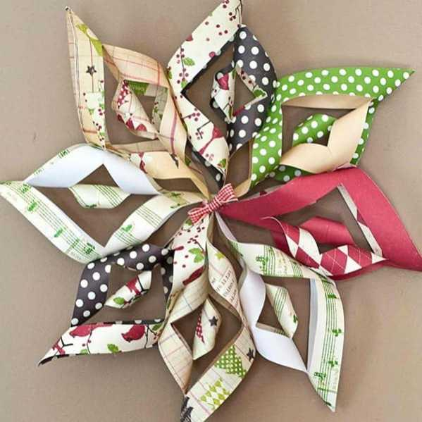 A star ornament made from different pieces of paper.
