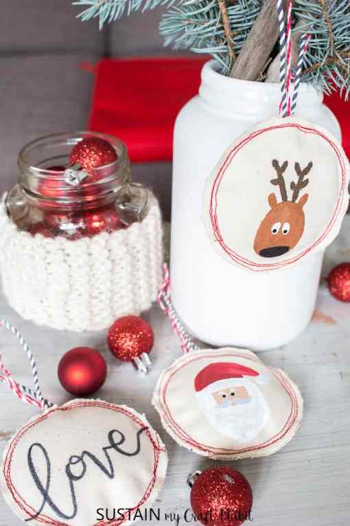 Cute reindeer, santa and love hand drawn ornaments on canvas.