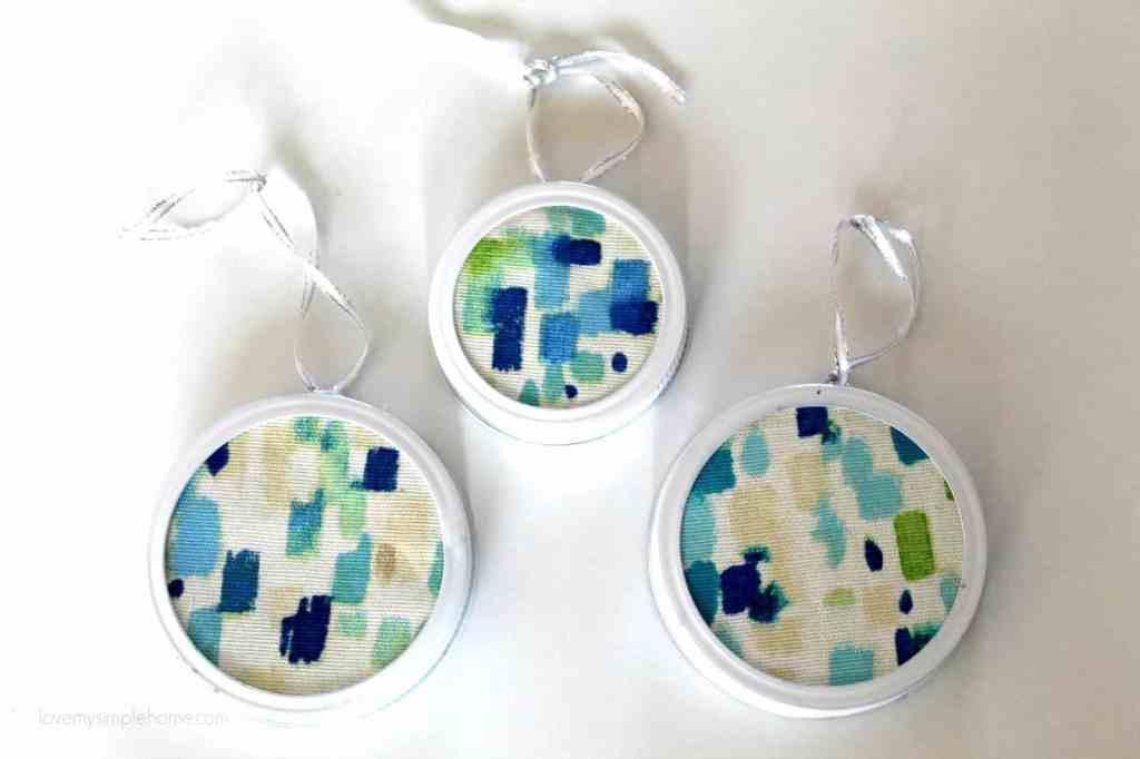 Abstract art fabric inside a white mason jar lid. Easy ornament DIY