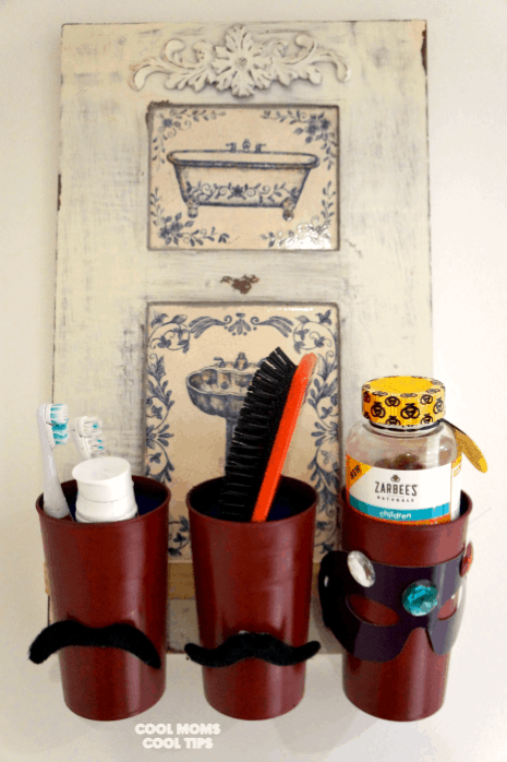 DIY cute bathroom caddy for kids. Cups and a vintage sign