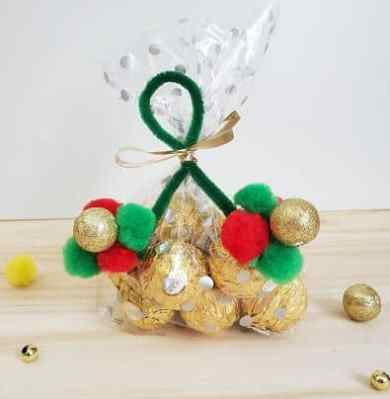 Candy grouped together in an ornament to tie on to trees and presents.
