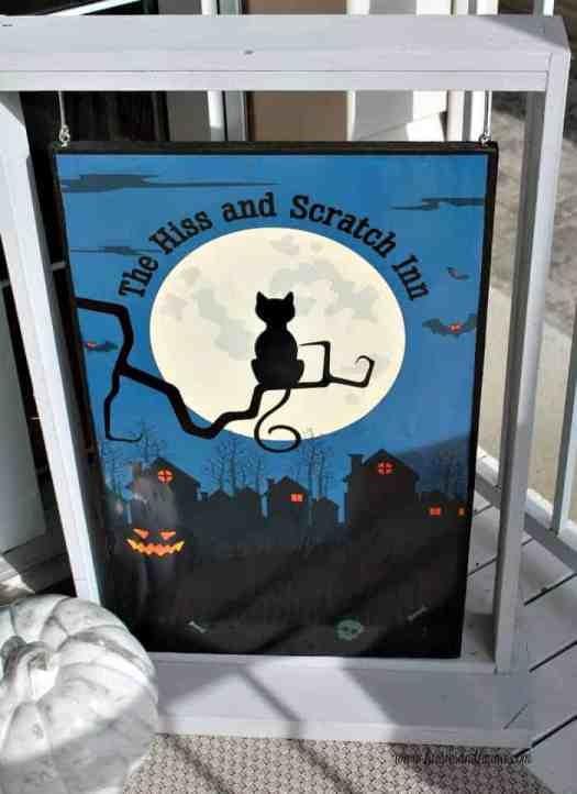 DIY Halloween raft idea: A vintage spooky poster on wood as a porch sign a cheap DIY home decor idea