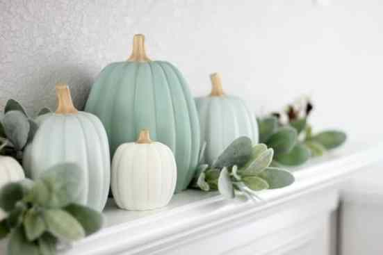 Teal Halloween pumpkins on a white mantel