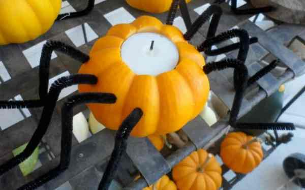 A DIY Halloween pumpkin spider candle holder