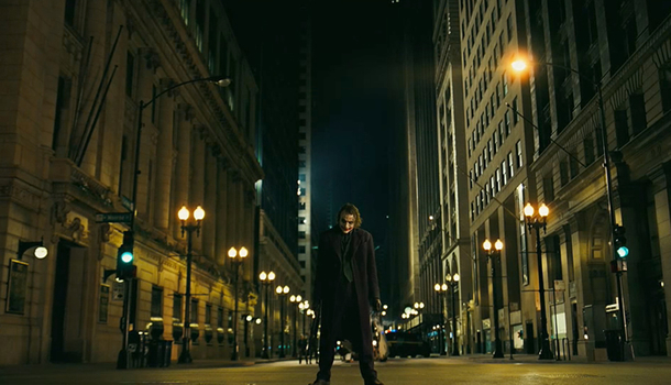 The Joker standing in the streets of Gotham City