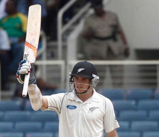 Latham celebrates after scoring his maiden Test half-century