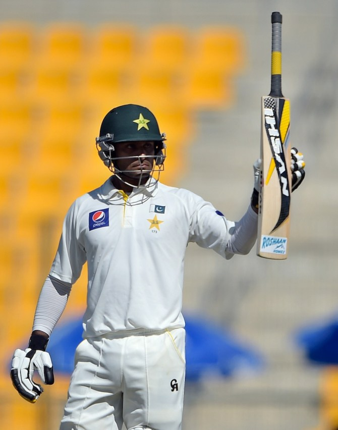 Hafeez raises his bat after scoring his sixth Test century