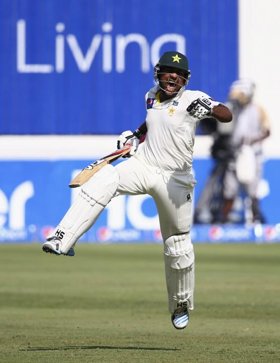 Ahmed leaps in the air after scoring his third Test century
