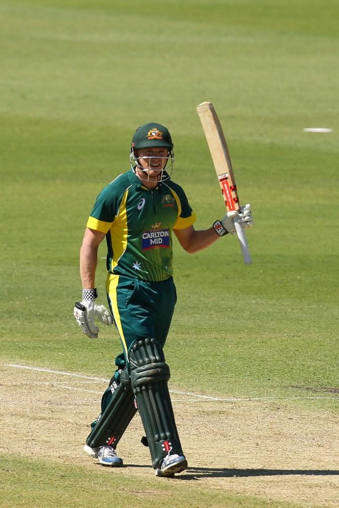 Bailey raises his bat after scoring his 14th ODI half-century