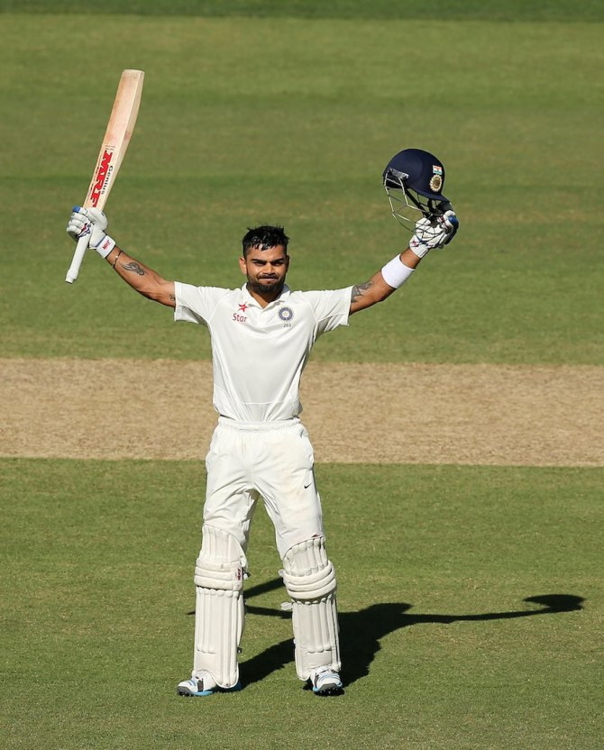 Kohli celebrates after scoring a century in his first Test as captain