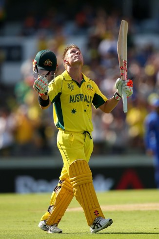 Warner celebrates after scoring his fourth ODI century