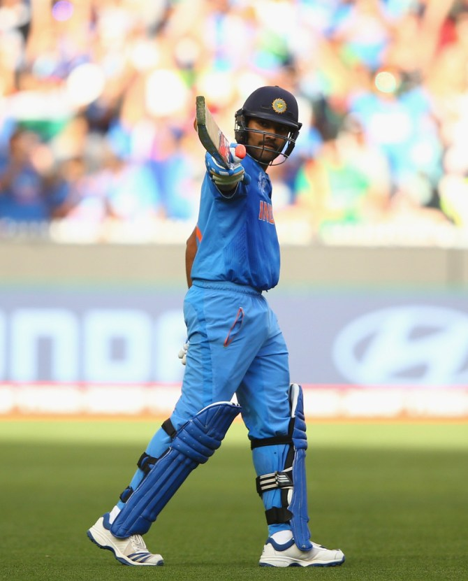 Sharma celebrates after scoring his seventh ODI century